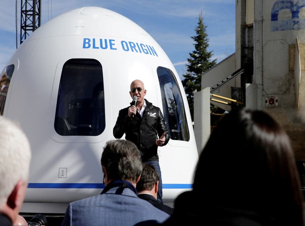 <p>Amazon and Blue Origin founder Jeff Bezos addresses the media about the New Shepard rocket booster and Crew Capsule mockup at the 33rd Space Symposium in Colorado Springs</p>