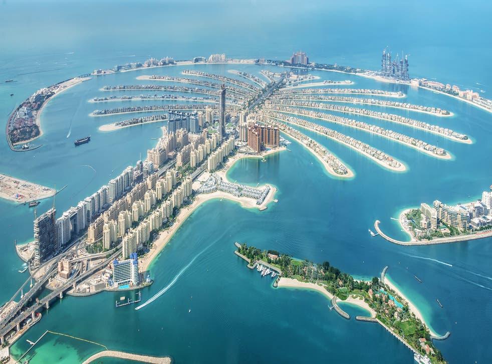 <p>An aerial view of Dubai Palm Jumeirah island, United Arab Emirates</p>