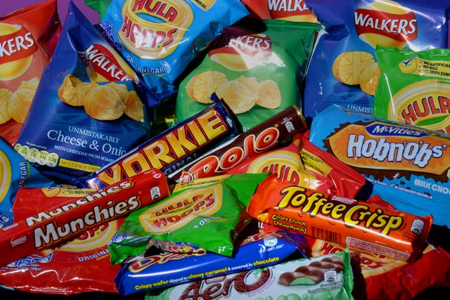 A collection of biscuits, crisps, chocolate bars and carbonated drinks