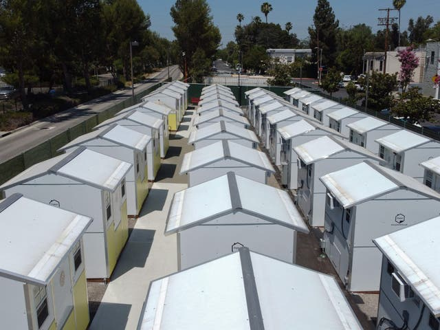 <p>A view of housing units at the Tarzana Tiny Home Village which offers temporary housing for homeless people, is seen on9 July 2021 in the Tarzana neighborhood of Los Angeles, California</p>