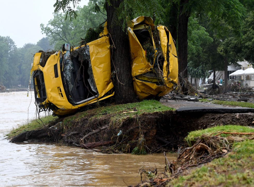 <p>A van crushed by the torrents is wedged against a tree after the floods wreaked havoc in Bad Neuenahr-Ahrweiler, western Germany</p>