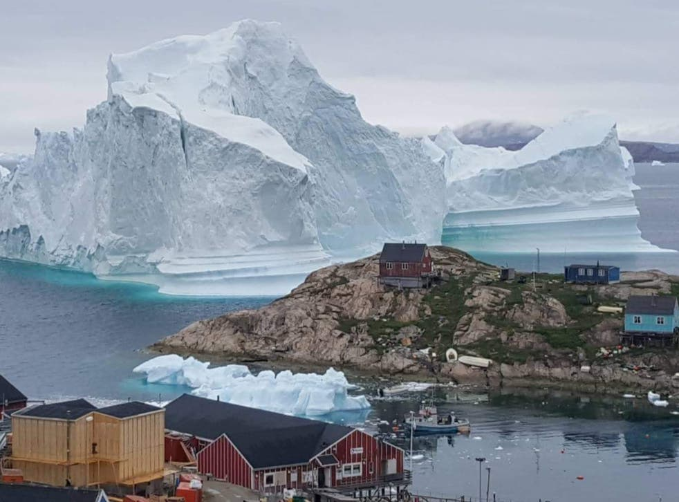 <p>An iceberg grounds  in north-western Greenland. Retreating ice could allow access to billions of gallons of oil</p>