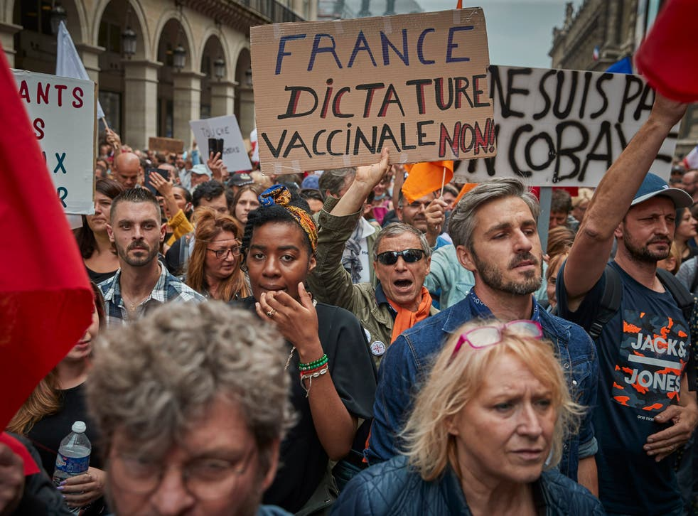 <p>Anti-vaccine protesters march through the streets of Paris</p>