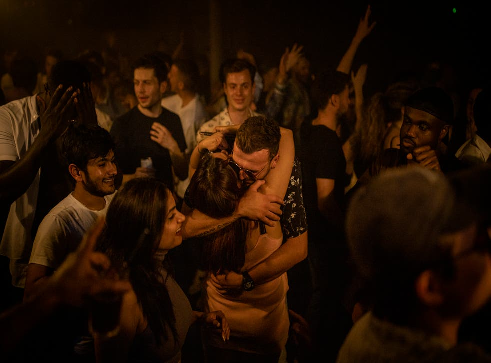 <p>Two people hug in the middle of the dancefloor at Egg London on 'freedom day'</p>