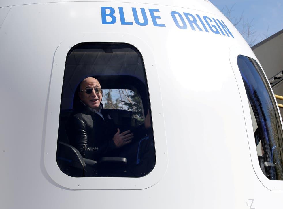 <p>Jeff Bezos addresses the media from inside Blue Origin</p>