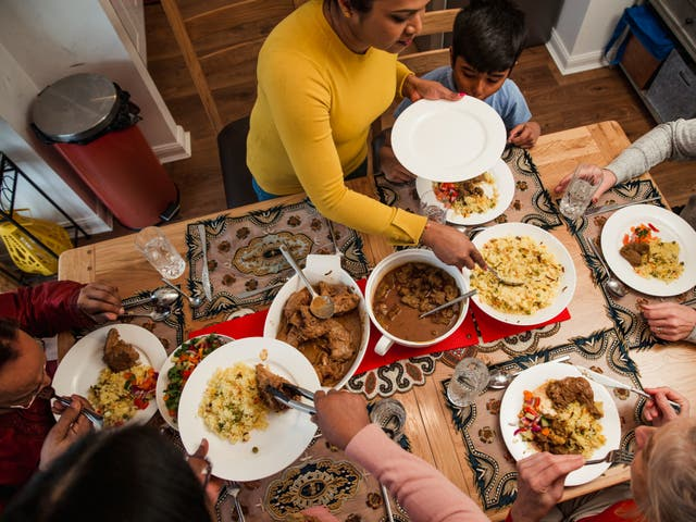 <p>A family eats together on Eid</p>