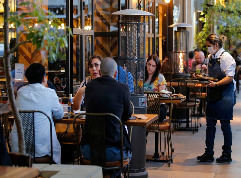 <p>Representational: People eat at a restaurant in Santiago on 19 July after Covid relaxations</p>