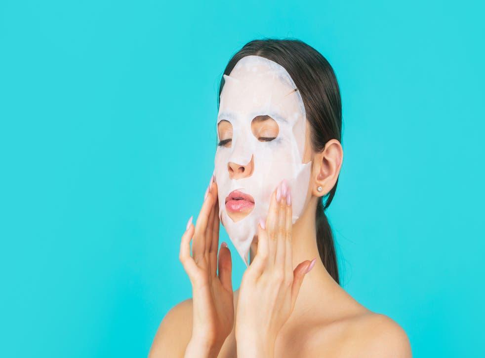 <p>Woman wearing skincare sheet mask</p>