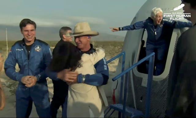 <p>Billionaire businessman Jeff Bezos, recent Dutch high school graduate Oliver Daemen and pioneering female aviator Wally Funk emerge from their capsule after their flight aboard Blue Origin's New Shepard rocket on the world's first unpiloted suborbital flight near Van Horn, Texas</p>