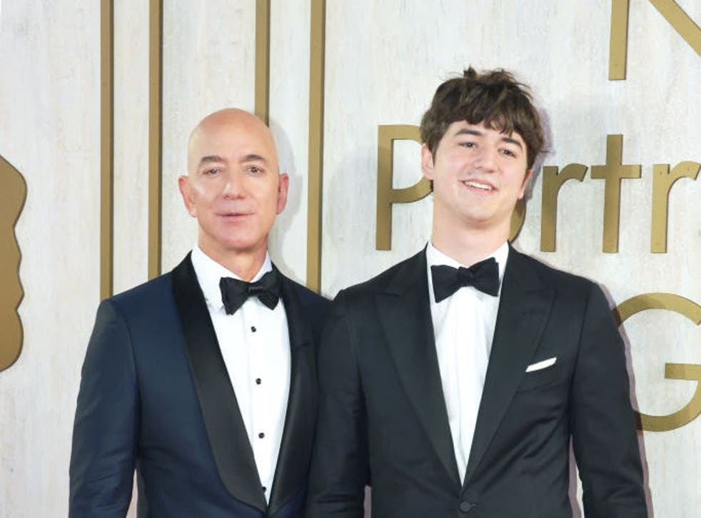 <p>Jeff Bezos with his son Preston Bezos in 2019</p>