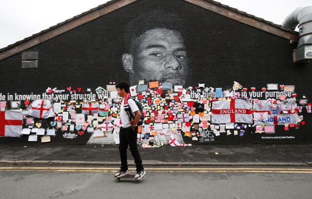 <p>Marcus Rashford mural covered with messages of support after it was defaced following the Euro 2020 Final between Italy and England</p>