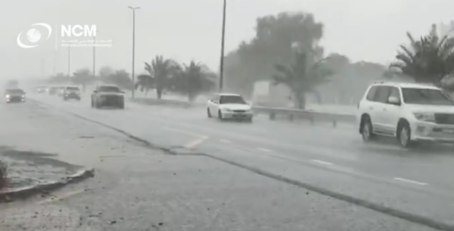 <p>Artificial rain pounds the streets of Dubai this week</p>