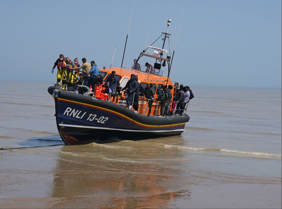 <p>A group of people thought to be migrants crossing from France are brought ashore by the local lifeboat at Dungeness, Kent</p>