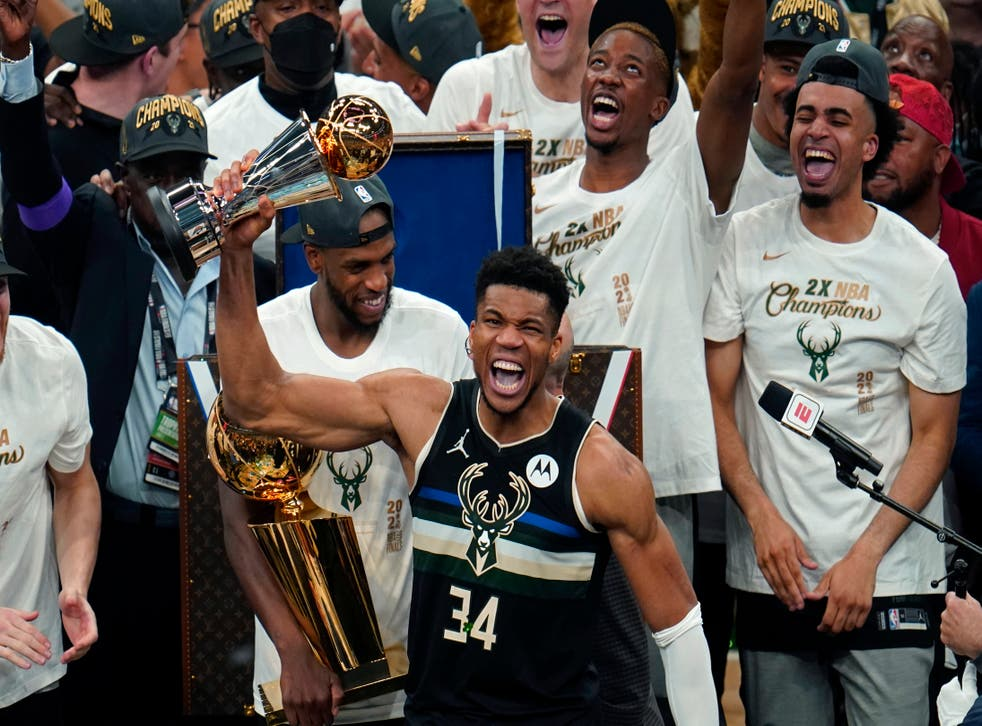 <p>Milwaukee Bucks forward Giannis Antetokounmpo (34) holds the finals MVP trophy after the Bucks defeated the Phoenix Suns in Game 6 of basketball's NBA Finals</p>