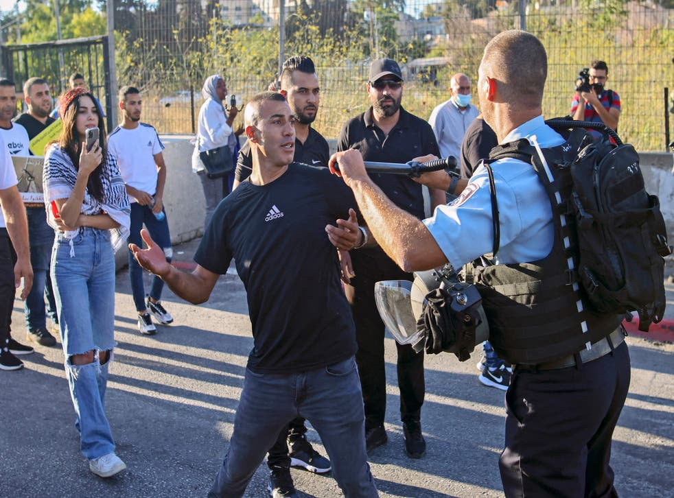 <p>A Palestinian protester scuffles with a member of Israeli security forces near a roadblock at the entrance of the Sheikh Jarrah neighbourhood in east Jerusalem during a rally against the planned expulsion of Palestinians from houses there</p>