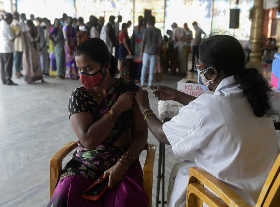 <p>A health worker inoculates a woman with a dose of a Covid-19 vaccine at a centre in Hyderabad on 15 July 2021</p>