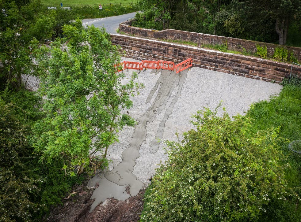 <p>Campaigners are furious that the historic bridge was filled in with an estimated 1,000 tonnes of concrete</p>