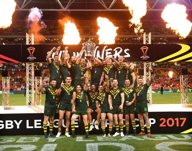 <p>Australia pose with the trophy after the final of the 2017 Rugby League World Cup (Gregg Porteous/PA)</p>