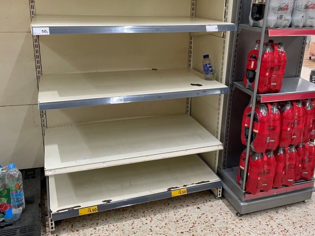 Public urged not to panic buy as 'pingdemic' blamed for supermarket shortages