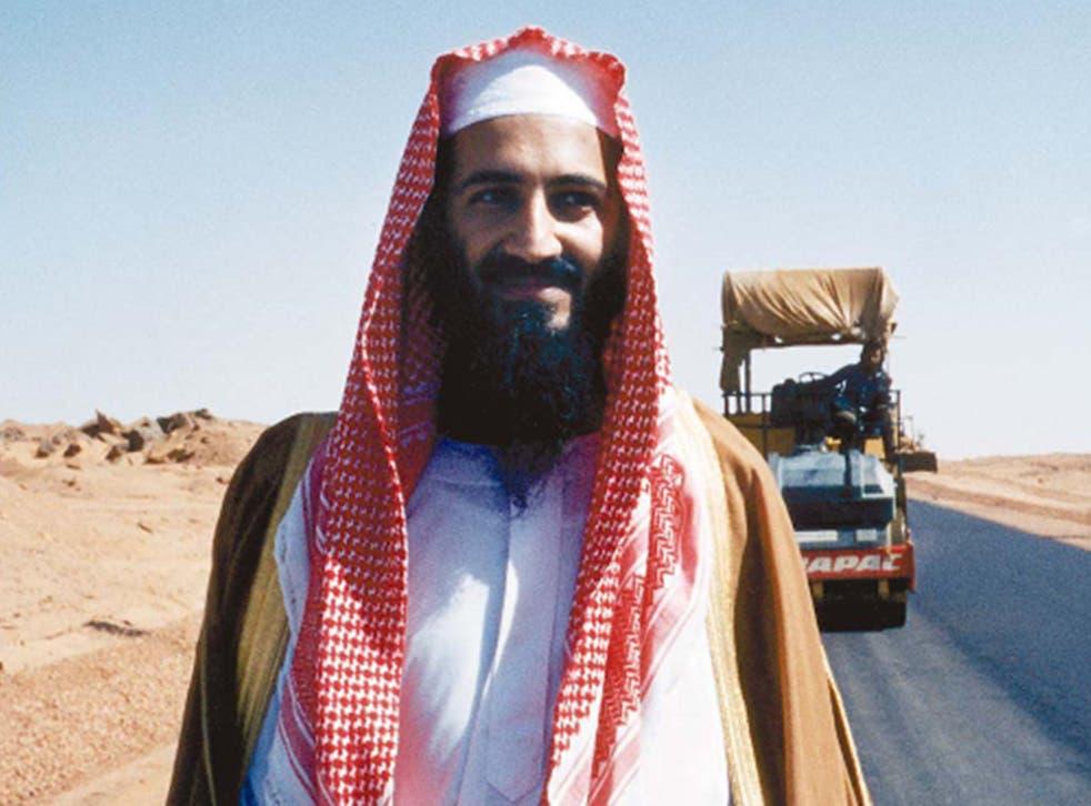<p>Bin Laden poses by his new desert road, Sudan, 1993</p>