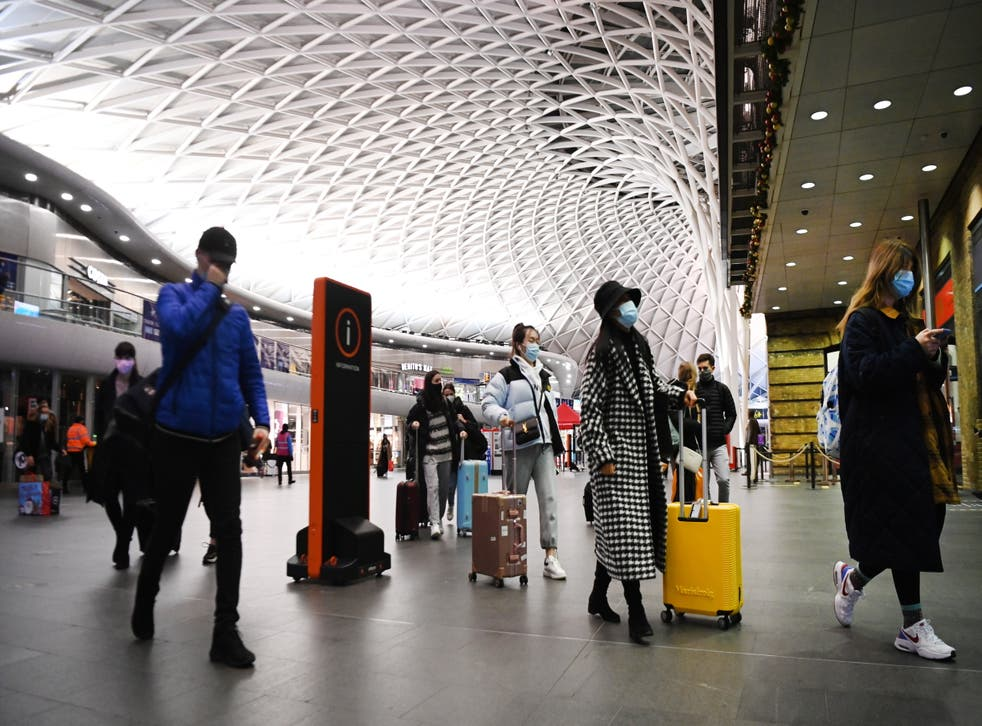 <p>People at Kings Cross train station in London on December 20</p>