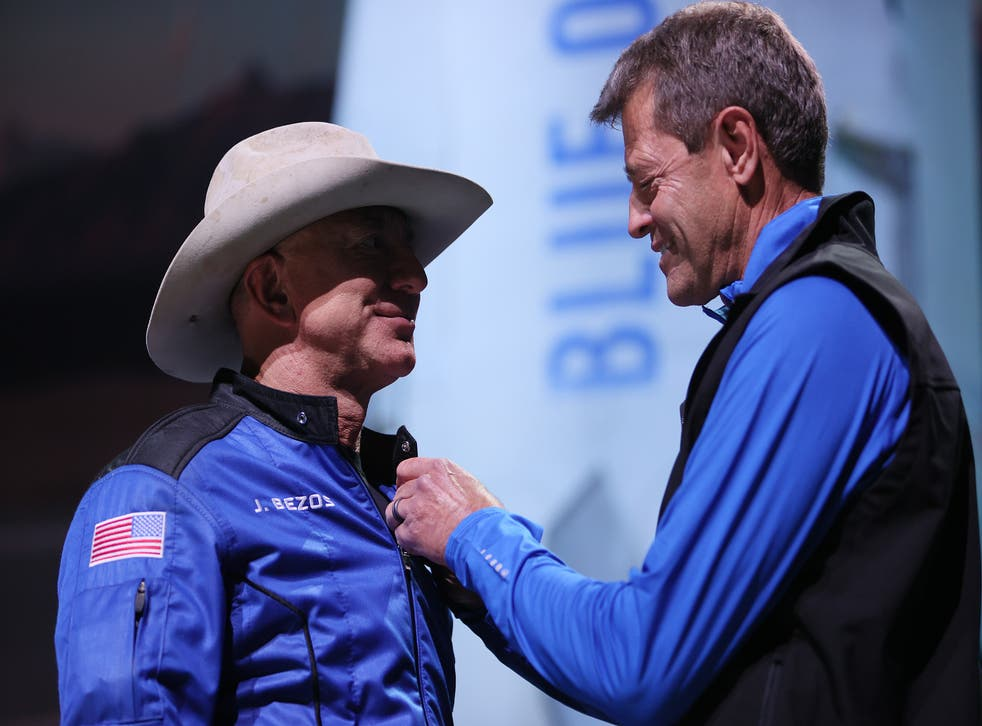 <p>Jeff Bezos receives astronaut wings from Blue Origin's Jeff Ashby, a former Space Shuttle commander</p>