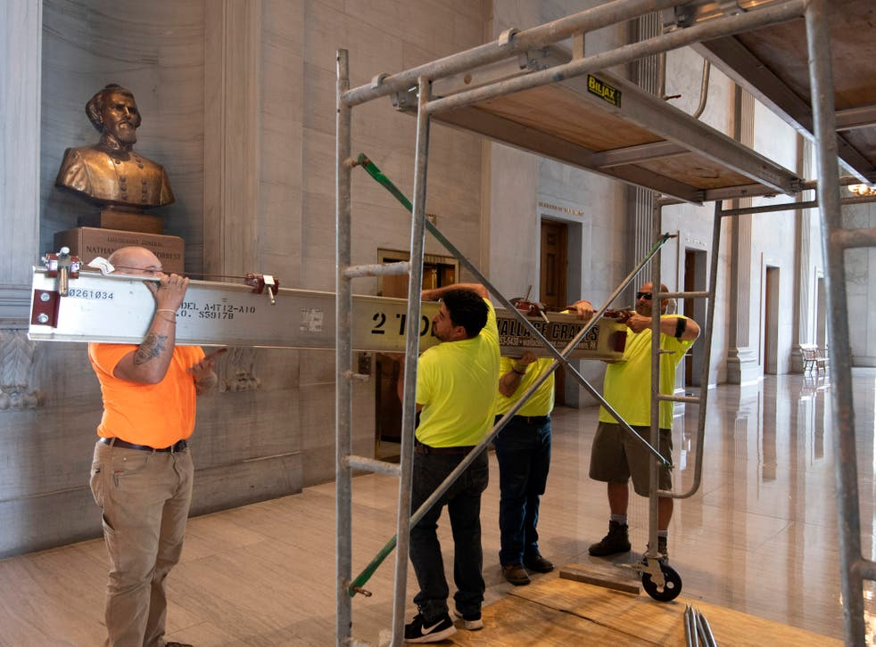 <p>Workers prepare scaffolding in front of a bust of Confederate General and early Ku Klux Klan leader Nathan Bedford Forrest at the State Capitol Thursday, 22 July 2021 in Nashville, Tennessee. </p>