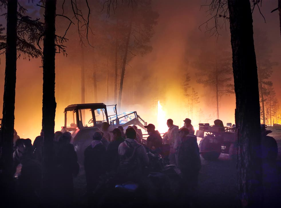 <p>Volunteers prepare to douse a forest fire in the republic of Sakha also known as Yakutia, Russia Far East</p>