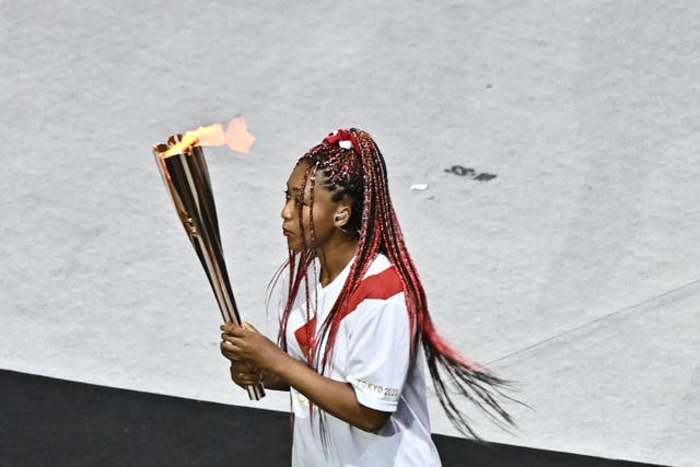 Naomi Osaka carries the Olympic torch