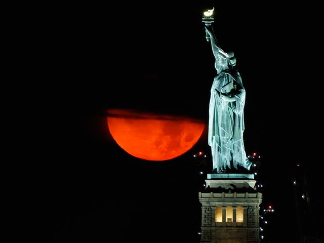 <p>The blood-red moon rising over New York on Thursday night.</p>