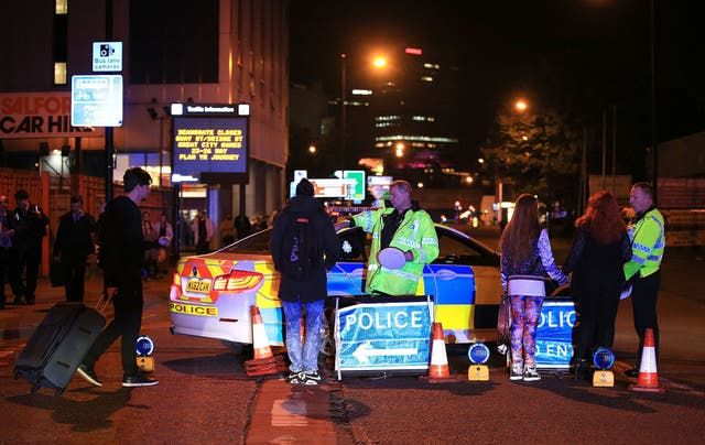 <p>Emergency services at Manchester Arena after reports of an explosion at the venue during an Ariana Grande gig</p>