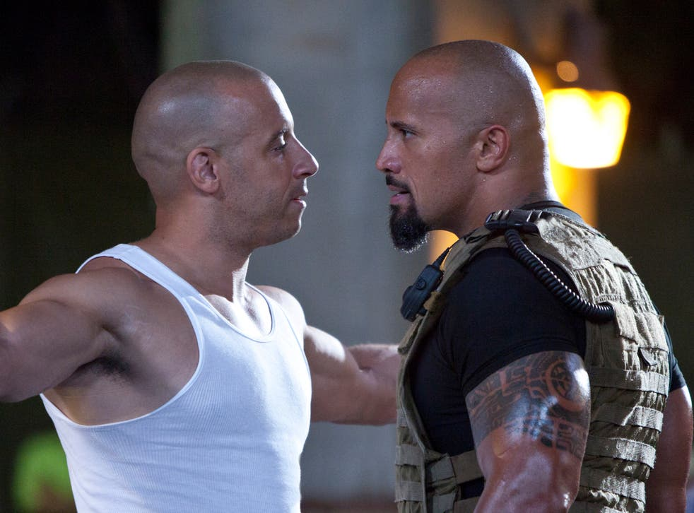 <p>Facing off: Vin Diesel and Dwayne 'The Rock' Johnson square up in 'Fast Five'</p>