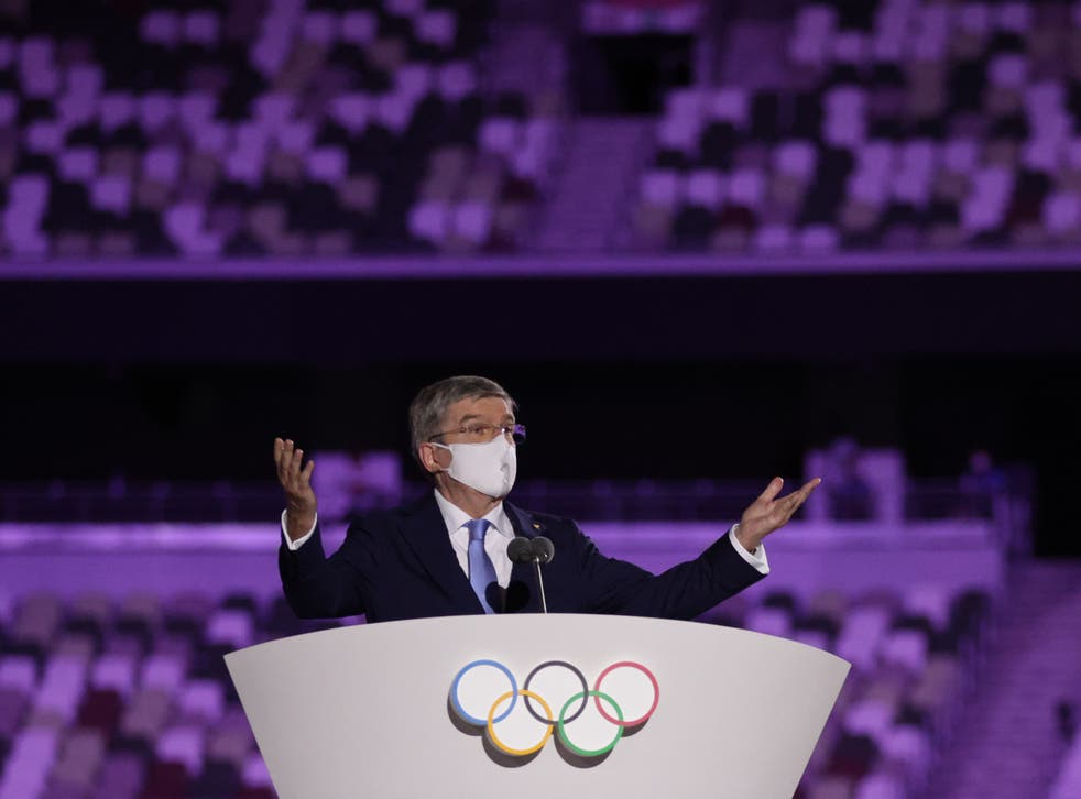 <p>International Olympic Committee (IOC) President Thomas Bach wearing a protective face mask speaks during the opening ceremony.</p>