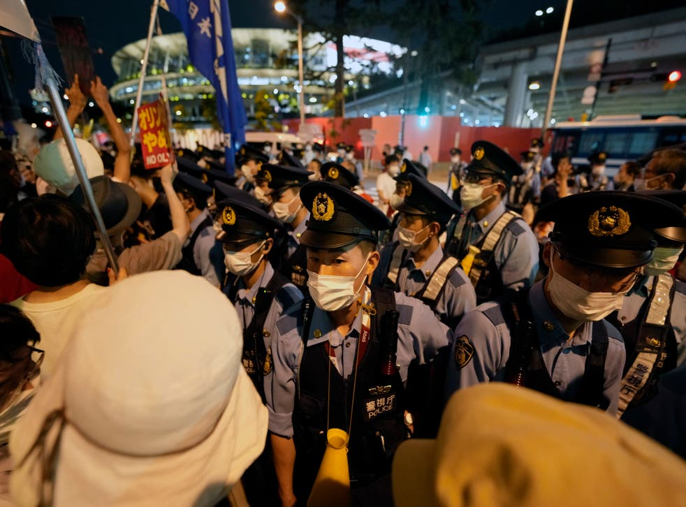 <p>People stage a protest before the National Stadium during the opening ceremony of the Tokyo 2020 Games</p>