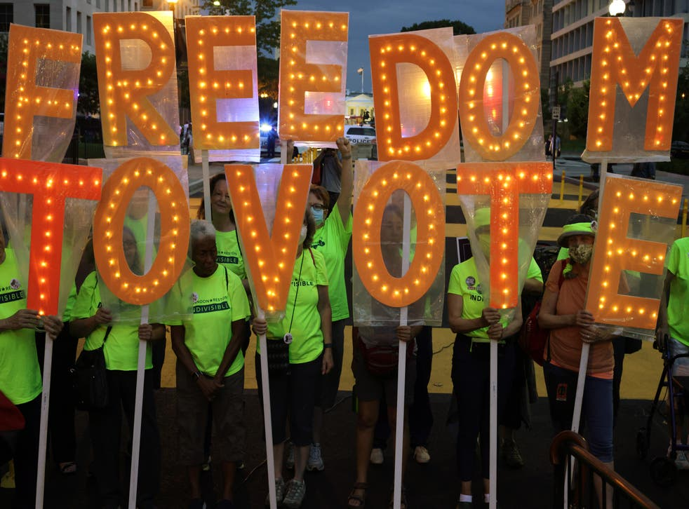 <p>Voting rights activists march in Black Lives Matter Plaza in Washington DC on 17 July.</p>