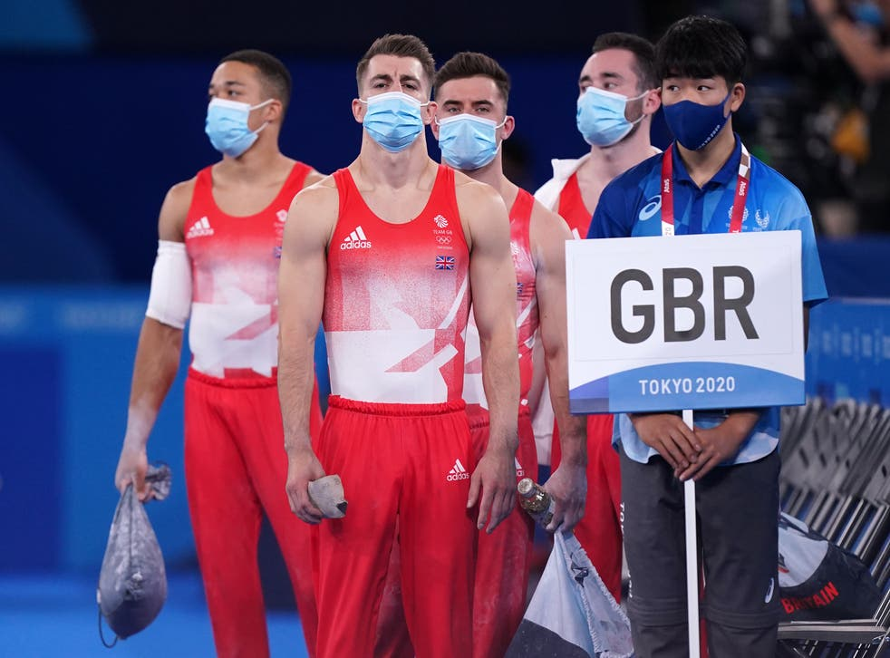 <p>Max Whitlock, second left, gets his gymnastics campaign under way in Tokyo (Mike Egerton/PA)</p>