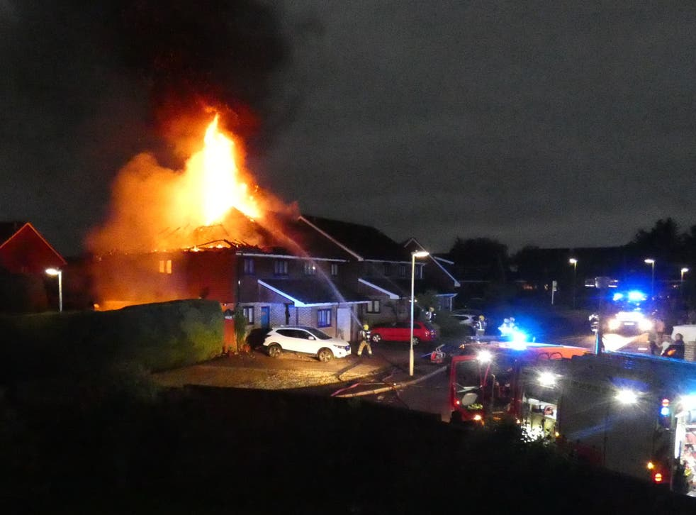 <p>Firefighters tackle a blaze after lightning struck two semi-detached houses in Andover, Hampshire, on Saturday morning</p>