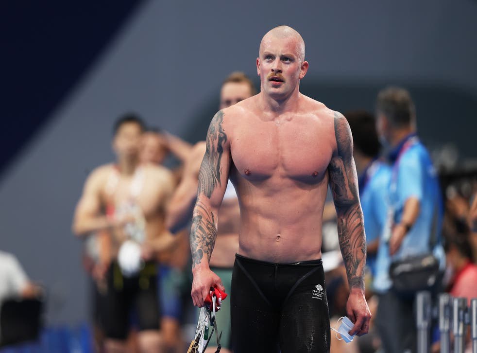 <p>Adam Peaty walks away after winning his heat</p>