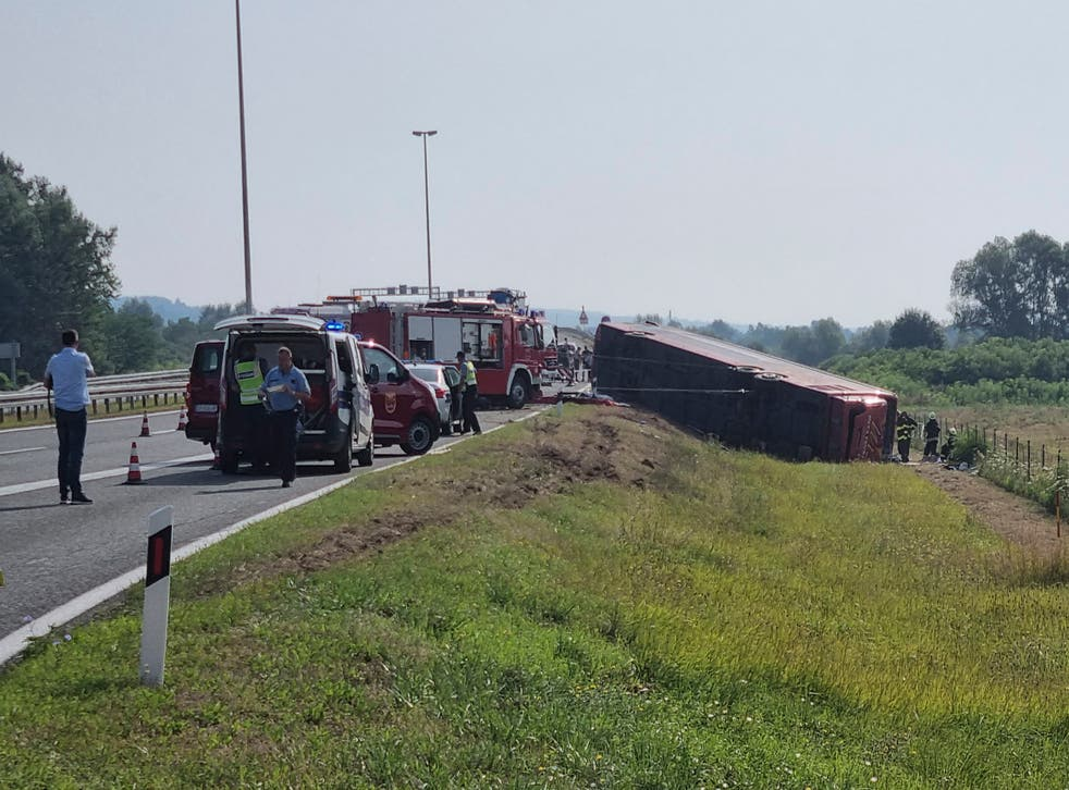 <p>Emergency crews work at the site of a bus accident near Slavonski Brod, Croatia, Sunday, July 25, 2021</p>