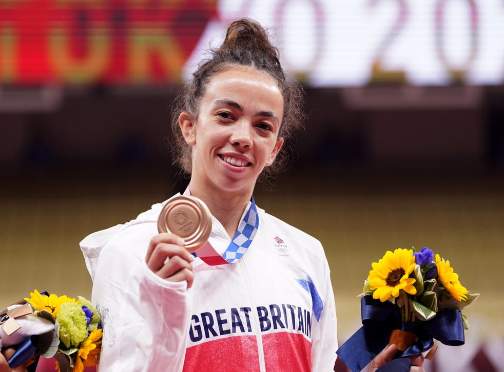 <p>Chelsie Giles shows off her bronze medal, Team GB's first medal of Tokyo 2020</p>