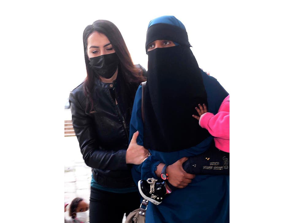 <p>File: The woman, suspected to be linked to Isis, being escorted by Turkish police in February</p>