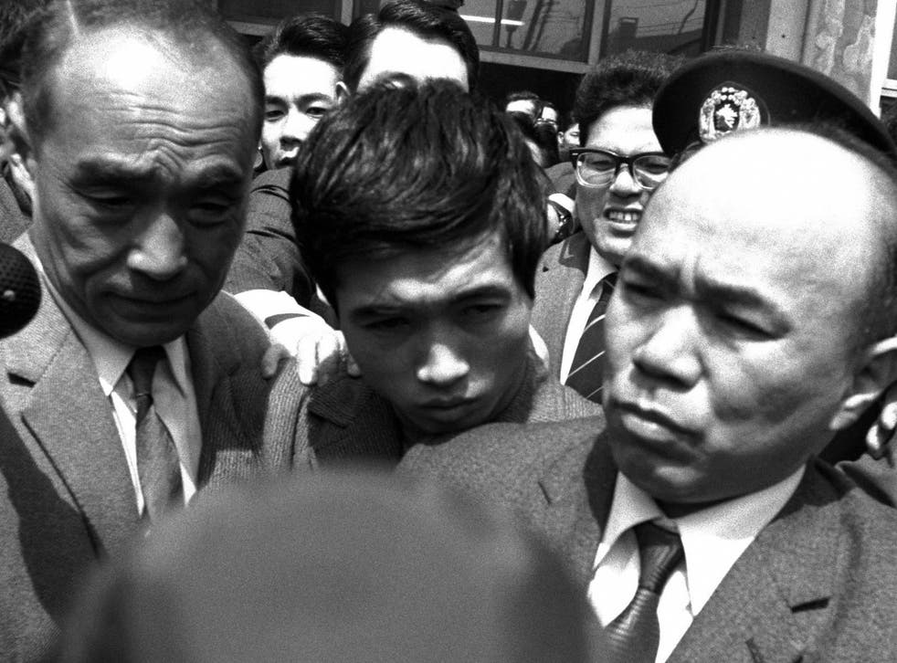 <p>Nagayama is arrested at Yoyogi Police station in Tokyo in 1969 </p>
