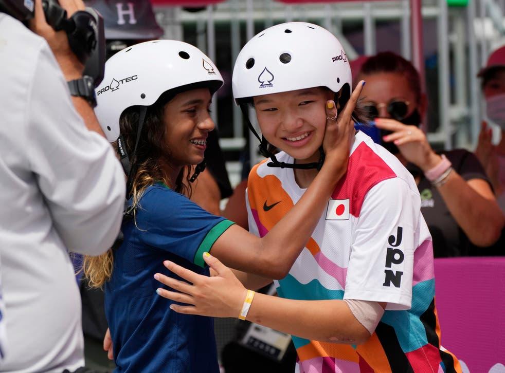 <p>Silver medallist Rayssa Leal of Brazil congratulates gold medal winner Momiji Nishiya of Japan after the women's street skateboarding finals at the 2020 Olympics</p>