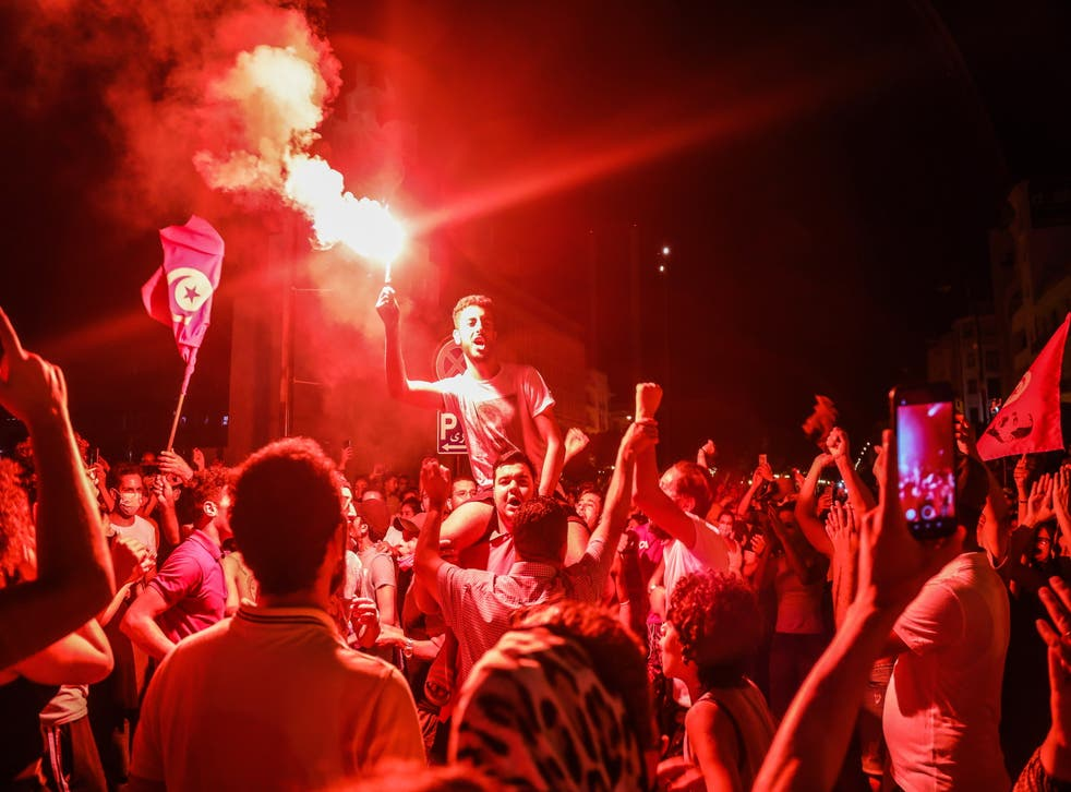 <p>Supporters of Tunisia's President Kais Saied gather on the streets after he dismissed the government and froze parliament, in Tunis</p>