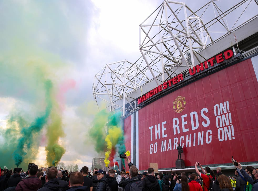 <p>Fans let off flares as they protest against the Glazer family (Barrington Coombs/PA)</p>