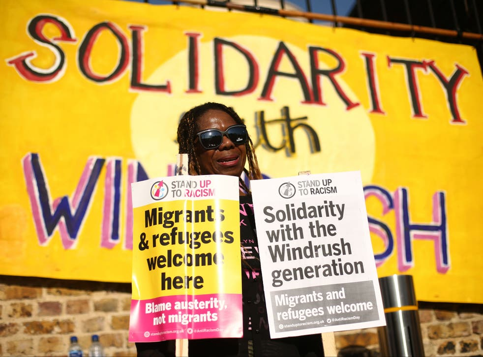 <p>A woman at a protest in Windrush Square, Brixton, in solidarity with Windrush scandal victims</p>