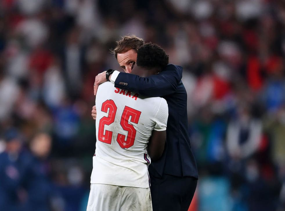 <p>England player Bukayo Saka is consoled by Gareth Southgate after his Euro 2020 penalty </p>