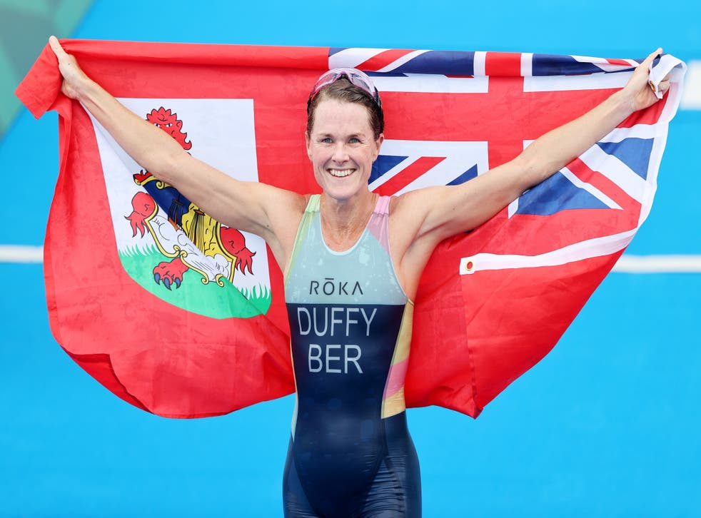 <p>Flora Duffy celebrates claiming gold for Bermuda</p>