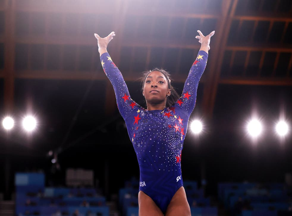 <p>Simone Biles of Team United States competes on vault during Women's Qualification on day two of the Tokyo 2020 Olympic Games</p>