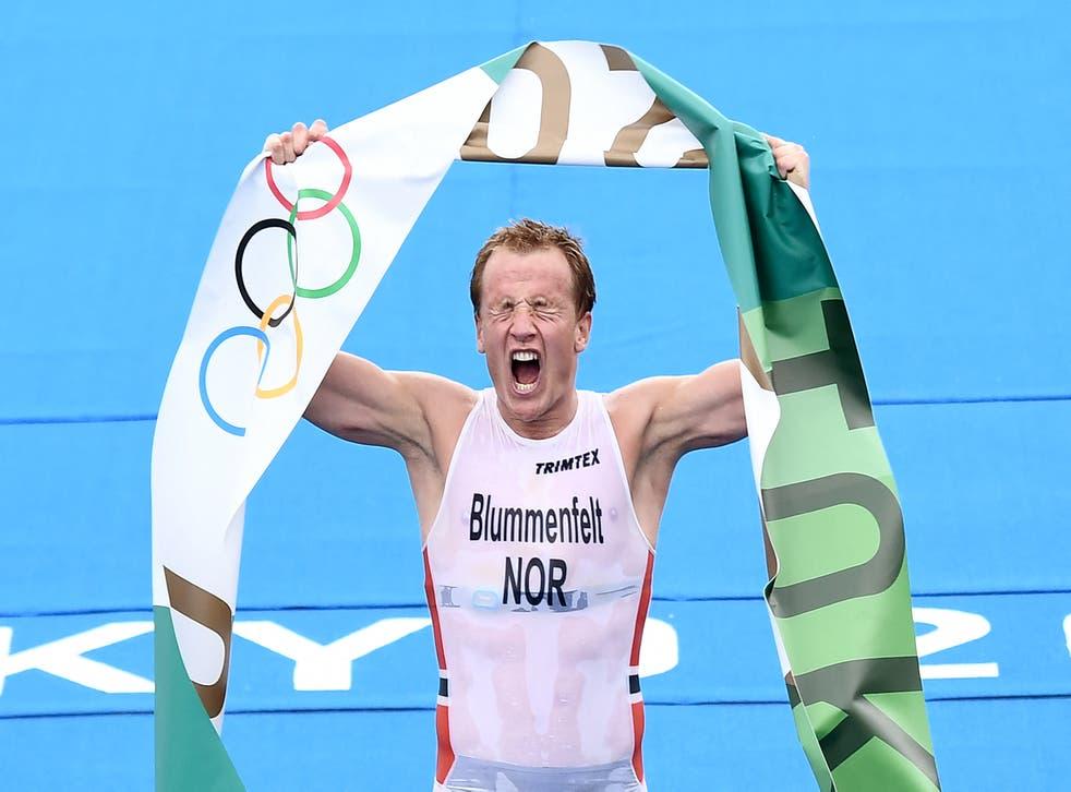 <p>Norway's Kristian Blummenfelt celebrates at the Odaiba Marine Park in Tokyo</p>